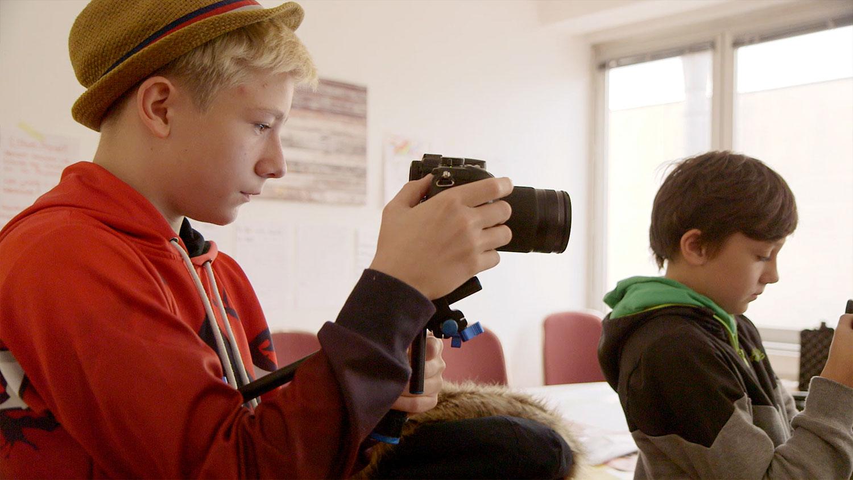 openion-junge-kamera